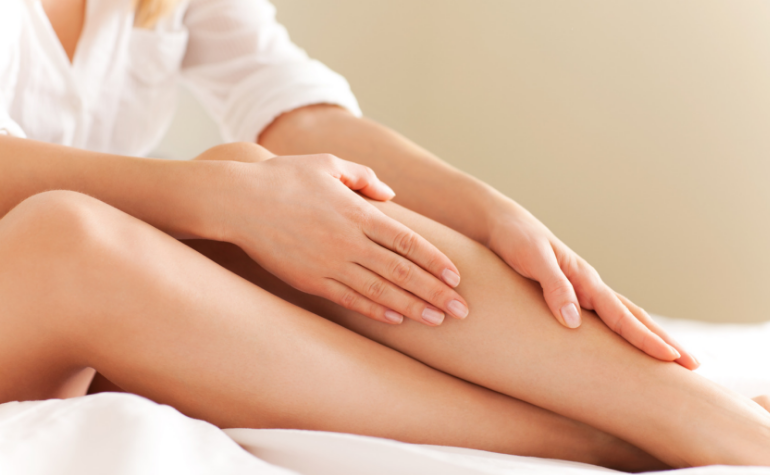 a lady stroking her legs after laser hair removal